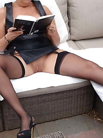 Mature businesswoman is posing fully undressed