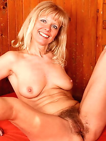 Zealous mature strumpet is masturbating herself